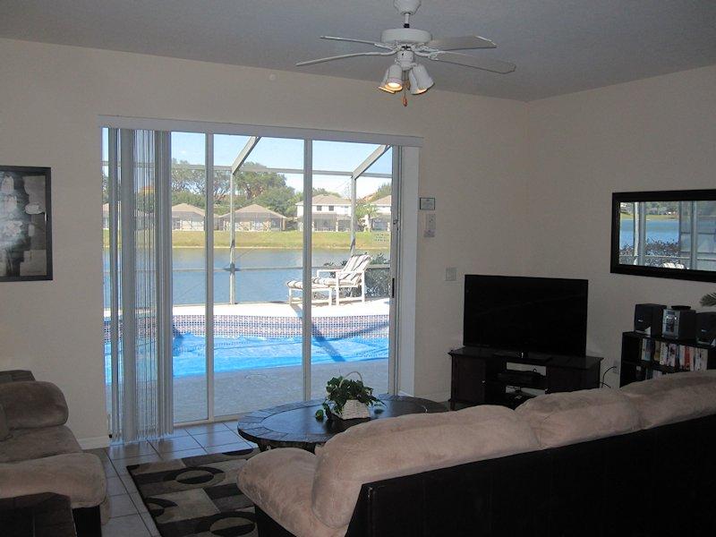 Living Room with pool & lake view